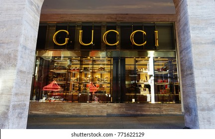 LUGANO, SWITZERLAND - NOVEMBER 27, 2017: flared sign of Gucci store. Gucci is an Italian fashion and leather goods brand founded by Guccio Gucci in Florence in 1921.