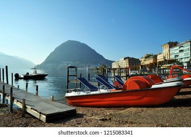 Lugano, Switzerland - October 19, 2018: Lugano lake with typical boats