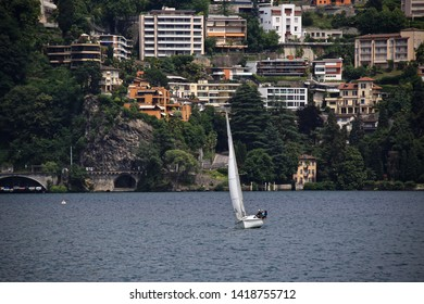 Lugano, Switzerland-June 17, 2014: Sailboat on the lake Lugano.