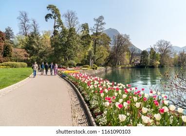 Lugano, Ticino, Switzerland - July 27, 2018: Tourists visiting Ciani Park on the long coast of Lake Lugano in the Lugano city, Switzerland