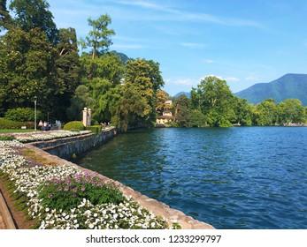 LUGANO, TICINO, SWITZERLAND - JUNE, 2018: Beautiful view on the Lake Lugano from Parco Ciani in Switzerland.