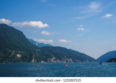 LUGANO, TICINO, SWITZERLAND - JUNE, 2018: Beautiful panoramic view on the Lake Lugano and boats from Parco Civico on a sunny day.