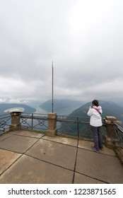 Lugano/Switzerland - August 24 2015: Monte San Salvatore on a cloudy and rainy day with a view to Lugano lake. The Monte San Salvatore (912 m) is a mountain in the Lepontine Alps above Lake Lugano.