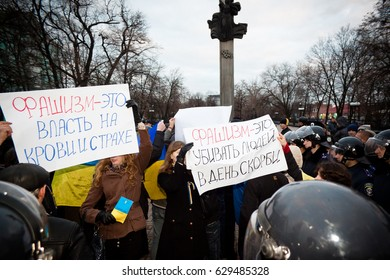 LUGANSK / LUHANSK, UKRAINE - APRIL 5, 2014: pro-Ukrainian activists, at a rally facing the police and holding placards in front of Russian aggression in Ukraine.