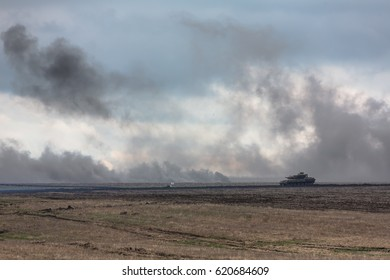 LUGANSK REG, UKRAINE - Apr 12, 2017: Armored units on combat duty. Training shooting from tanks. Weaponry and military equipment of the armed forces of Ukraine