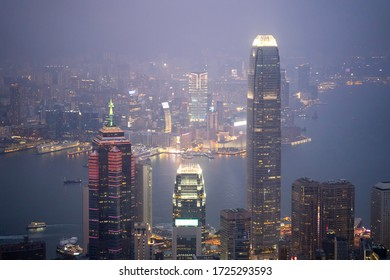 Lugard Road, Hoang Kong - January 1, 2020: Aerial view of sunset scene at Hong Kong city skyline during misty and hazy sky.