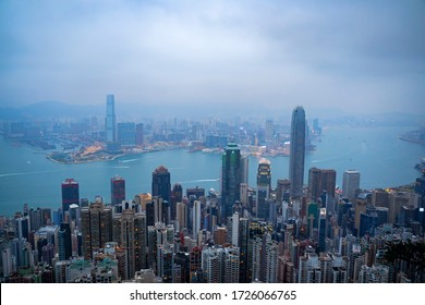 Lugard Road, Hoang Kong - January 1, 2020: Aerial view of Hong Kong city skyline during misty and hazy sunset.