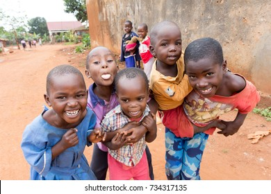 Lugazi, Uganda. 9 June 2017. A bunch of Ugandan children laughing, smiling, waving or making funny, wacky faces and contortions.