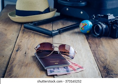 Luggage accessories passport and money on the wooden floor