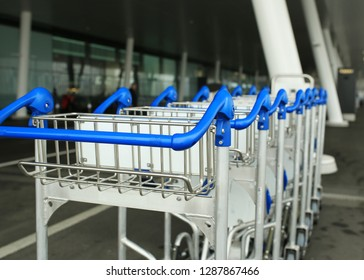 luggage carts in row in airport