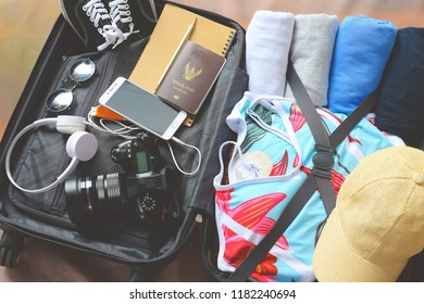 luggage  with clothing and accessories,  packing and getting ready to leave, travel and vacations concept