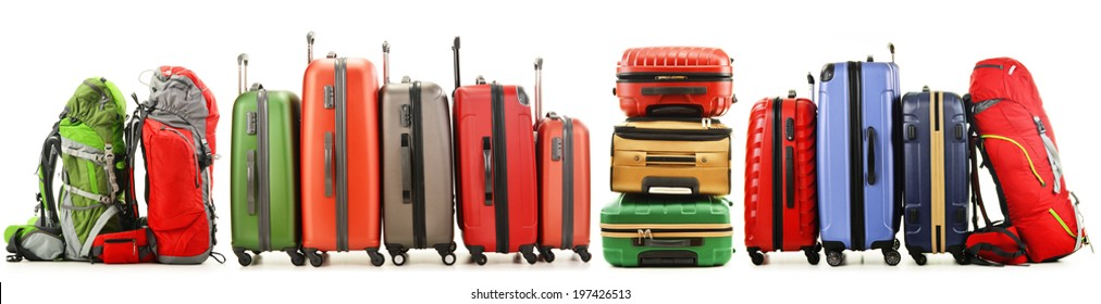 Luggage consisting of large suitcases and backpacks isolated on white.