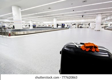 luggage with empty conveyor belt at airport