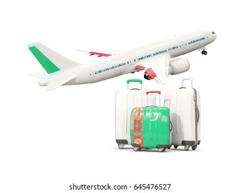 Luggage with flag of turkmenistan. Three bags with airplane isolated on white. 3D illustration