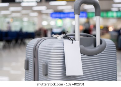 "Luggage holder tag blank label on suitcase / baggage put letter ""Travel insurance"" word for display your products near combination locks for traveling luggages in airport terminal, copy space for text"