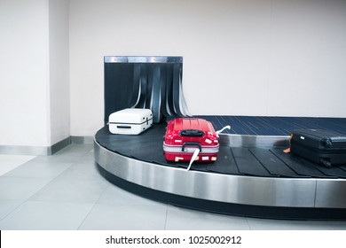 luggage and knapsack or backpack is conveyed through the conveyor belt in arrivals lounge of airport terminal