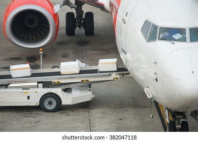 Luggage loading into a plane in an airport