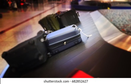 Luggage on airport carousel blurred
