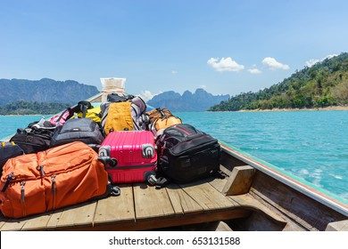 luggage on transport boat go to island