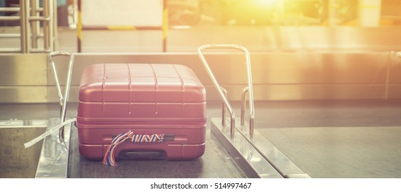 luggage at Point of checking the scanner. Baggage X-ray machine band on the conveyor belt at the airport counter.selective focus,vintage color