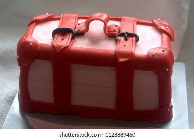 Luggage shaped cake red and pink color for travel theme