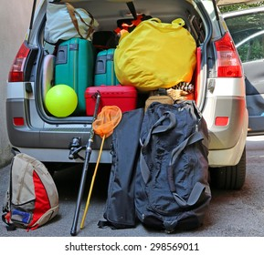 luggage and suitcases in car for departure for summer holidays