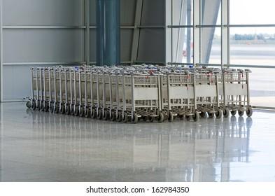 Luggage trolleys in airport terminal