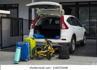Luggages and camping equipments ready to pack on car trunk
