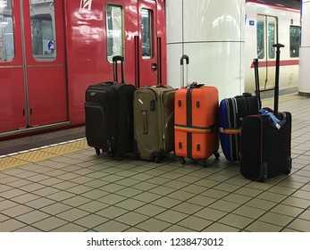 luggages queue up at a platform of train waiting for get in.