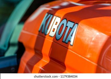 LUGO, ITALY - September 11, 2018: light enlightening KUBOTA logo on a tractor body