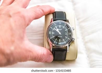 LUGO (RA), ITALY - NOVEMBER 18, 2018: hand of man showing vintage watch, Longines Legend Diver