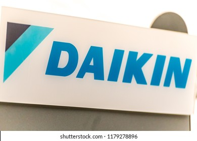 LUGO (RA), ITALY – SEPTEMBER 11, 2018: Dust and dirt covering the DAIKIN logo on signboard