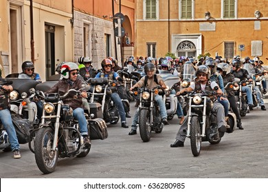 """LUGO, RA, ITALY - SEPTEMBER 22: group of bikers riding American motorbikes Harley Davidson during the motorcycle rally """"Sangiovese tour"""" by Ravenna Chapter on September 22, 2013 in Lugo (RA) Italy"""