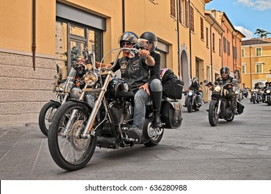 "LUGO, RA, ITALY - SEPTEMBER 22: bikers riding American motorbike Harley Davidson during the motorcycle rally ""Sangiovese tour"" by Ravenna Chapter on September 22, 2013 in Lugo, RA, Italy"