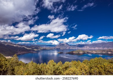 Lugu Lake is located in the North West Yunnan, China. The lake is surrounded by mountains and has five islands, four peninsulas, fourteen bays and seventeen beaches