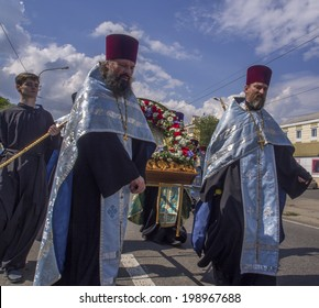 LUHANSK, UKRAINE - June 14, 2014: Priests and believes are on the streets of Lugansk. Religious procession in honor of Our Lady of Luhansk, which ended with a prayer for peace.