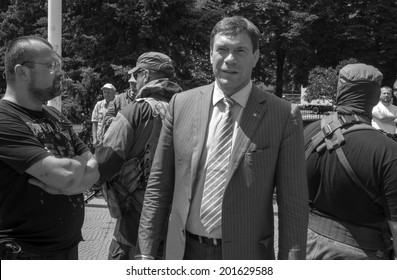 LUHANSK, UKRAINE - June 29, 2014: Armed representatives of private security company guarding the self-proclaimed Novorossia parliament speaker Oleg Tsarev during a speech at the rally