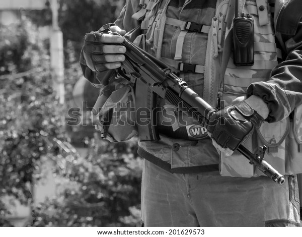 LUHANSK, UKRAINE - June 29, 2014: Armed representatives of private security company