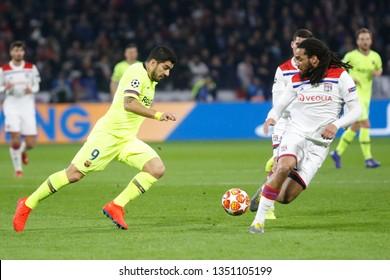 Luis Suarez of Barcelona and Denayer Jason of Lyon during UEFA Champions League round of 16 between Olympique Lyonnais and FC Barcelona 2/19/2019 Groupama stadium Decines-Charpieu Lyon France