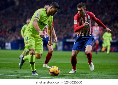 Luis Suarez of Barcelona and Lucas Hernandez during the week 13 of La Liga match between Atletico Madrid and FC Barcelona at Wanda Metropolitano Stadium in Valencia, Spain on November 24, 2018.