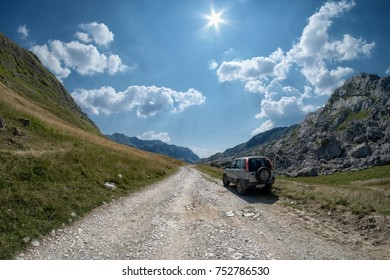 LUKAVICA, MONTENEGRO - JULY 20, 2017: off road car on a scenic but rough road of Montenegro Mountain