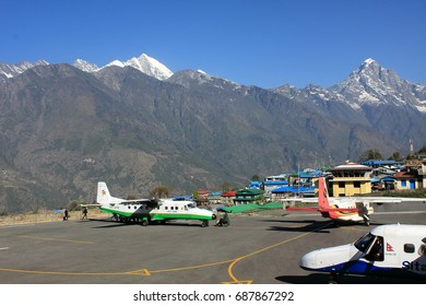 Lukla / Nepal - April, 2012: Small aircrafts at Lukla airport, one of the most dangerous airstrips in the world