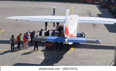 LUKLA, NEPAL - MAY 14, 2017 : Passengers go on the plane in the Tenzing-Hillary airport Lukla - Nepal, Himalayas