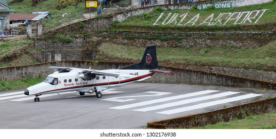 LUKLA, NEPAL - MAY 14, 2017 : The aircraft on the runway of the Tenzing-Hillary airport Lukla - Nepal, Himalayas