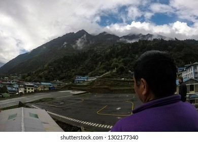 LUKLA, NEPAL, May 15, 2017: Flight passengers awaiting unpredictable flights to bad weather at the Tenzing-Hillary Lukla airport - Nepal, the Himalayas