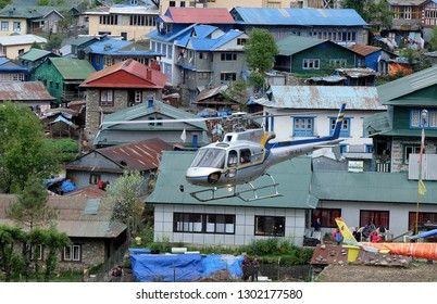 LUKLA, NEPAL, MAY 15, 2017: The rescue helicopter begins from a flying field around the Himalaya Mountains, Nepal.
