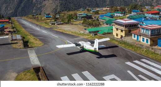 LUKLA, NEPAL - NOVEMBER 01, 2012: The aircraft on the runway of airport Lukla - Everest region, Nepal, Himalayas