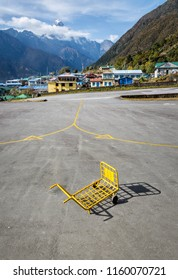 LUKLA, NEPAL - NOVEMBER 1, 2012: Luggage cart on the airfield of the Tenzing-Hillary airport Lukla - Nepal, Himalayas