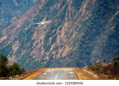 LUKLA/NEPAL, February 01 2019 Lukla airport. In the frame of the airport runway and taking off the plane. Nepal. Everest trekking.