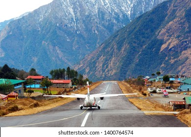 LUKLA/NEPAL, February 02 2019 Lukla airport. In the frame of the airport runway and taking off the plane. Nepal. Everest trekking.